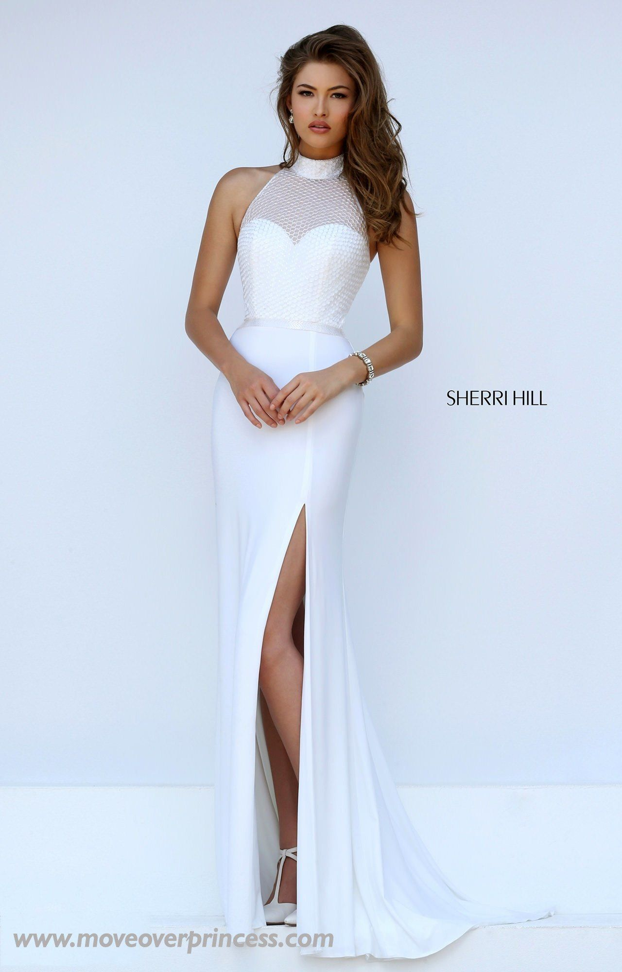 4bbbfdef6938 This Sherri Hill looks like a 2-piece from the back but it's solid in the  front! Perfect for the schools that won't allow actual 2-pieces!