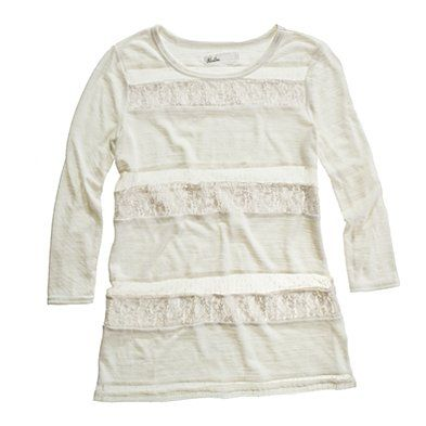 late night lace tee  was $58.00  select colors $44.99  Item# 58130  Casual glamour is the key to this charming triple-striped tee.  True to size.  Poly/wool jersey.  Hand wash.  Import.    looks great with a light striped tee underneath or a simple one color block tank with a longer length