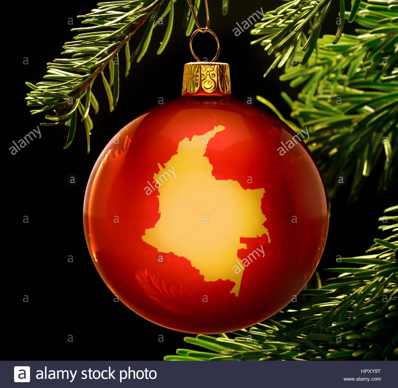 Http Www Alamy Com Stock Photo A Red Bauble With The Golden Shape Of Colombia Hanging On A Christmas 134587204 Html Christmas Bulbs Christmas Shapes