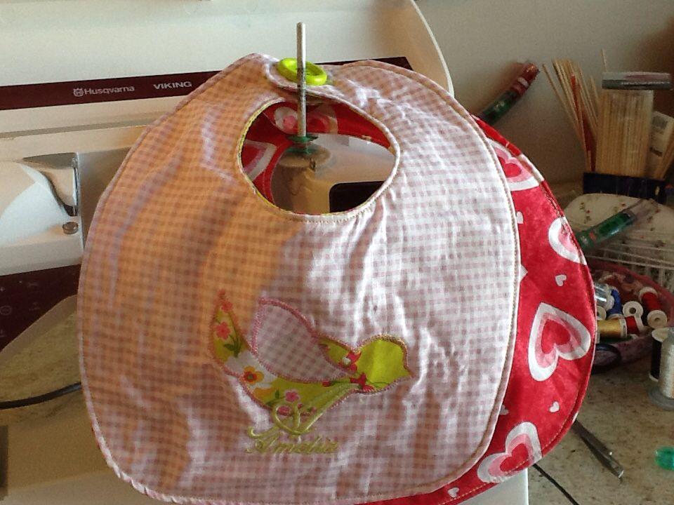 Appliqué work on a baby bib