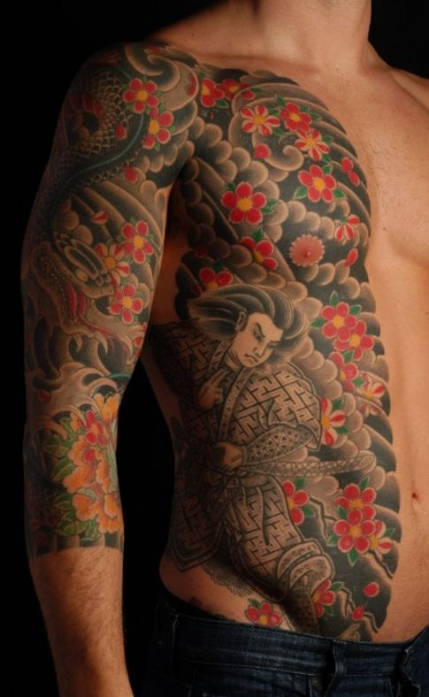 A Japanese Arm Tattoo Design With Some Flowers Waves And A Whirlwind Placed On The Shoulder Japanesesleeveta Werewolf Tattoo Mythology Tattoos Vampire Tattoo