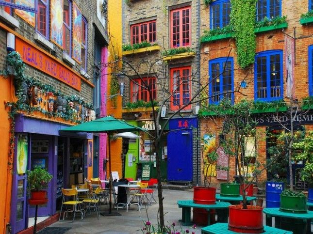 The 30 Most Colorful Buildings in the World via Brit + Co.  27. Neal's Yard, London: Located in London, Neal's Yard is hands down the cutest salad bar in the world. All the buildings in this little alcove are super artsy, making the alleyway something right out of a storybook.