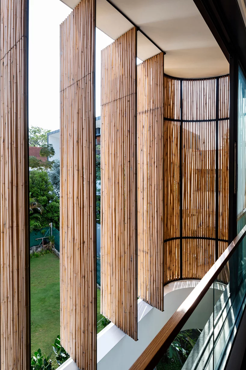 wallflower wraps house in singapore in a bamboo veil of operable screens