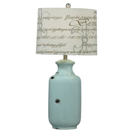 Ceramic table lamp in antiqued distressed blue with a script detailed drum shade product