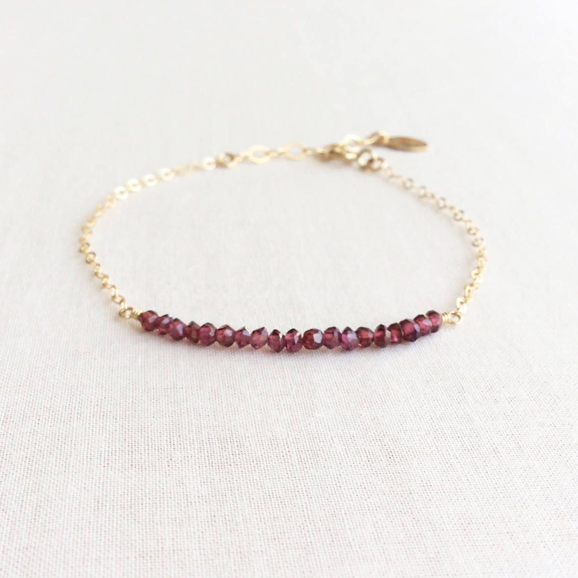 Tiny garnet bracelet garnet gold bracelet k birthstone