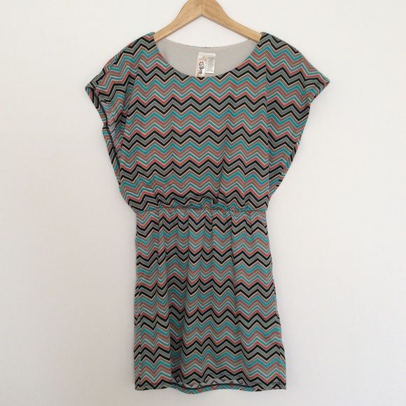 """L8ter Chevron Dress Fun zigzag print dress in Southwestern-inspired colors. There are large arm openings but a built-in cami top to keep you unexposed :) Unlined skirt. Marked size M but I think that's a juniors size - it fits like a ladies size S. 100% polyester. In lightly used condition with no stains, holes, or tears. This dress has lots of life left!  FLAT MEASUREMENTS: Free shoulders and bust 13"""" waist (stretches) 32.5"""" length  Reasonable offers considered. Thanks for looking! L8ter…"""