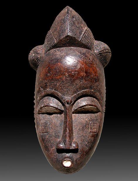 "BAOULE ' - Ivory Coast Mask female portrait "" Mblo "" Hardwood, pigments , kaolin."