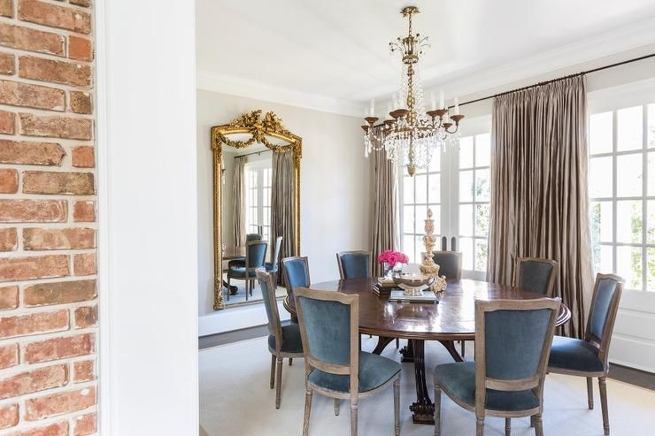 Superbe French Inspired Dining Room Features A Paris Flea Market Chandelier  Illuminating An Antique Round Dining Table