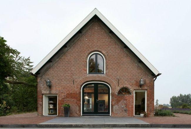 Photo of Umgebautes Haus mit Satteldach bietet offenes und großzügiges Wohnen