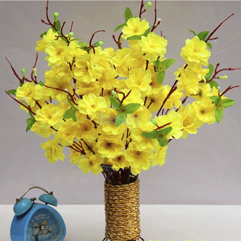 little yellow flowers glued to fake curly willow branches. Black Bedroom Furniture Sets. Home Design Ideas
