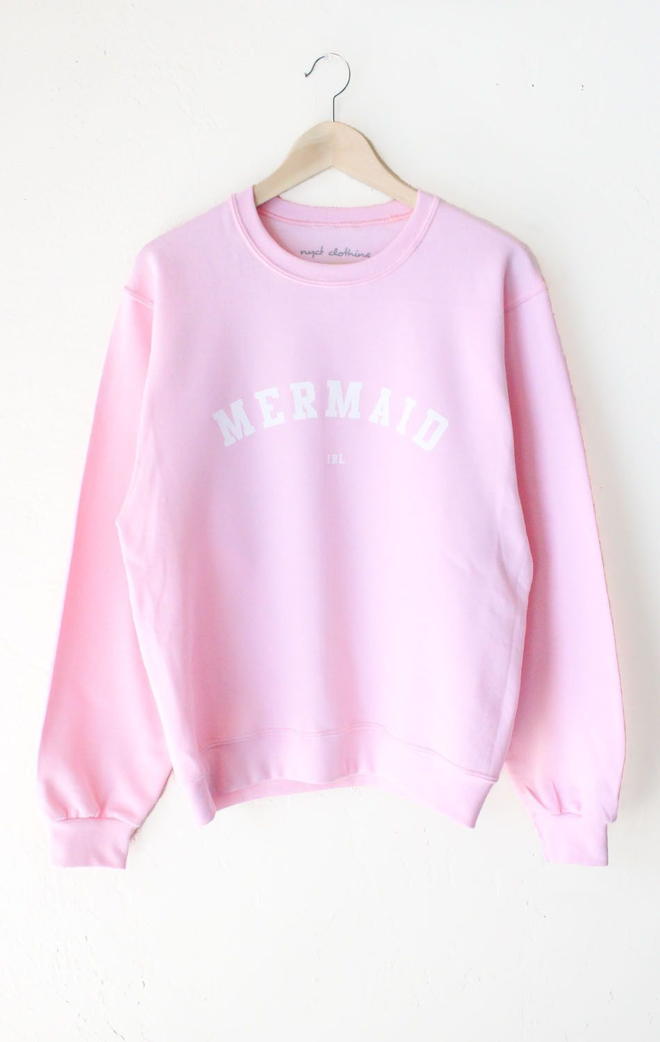 31961bb6 Description Details: Super cozy oversized sweatshirt in pink with print  featuring 'Mermaid IRL'. Brand: NYCT Clothing. Unisex, oversized/loose fit.