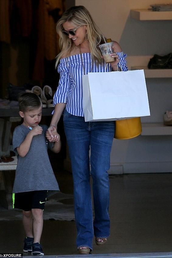 Reese Witherspoon wearing Christian Louboutin Almeria Espadrille Wedges, Draper James Howdy Y'All Iphone Case and Draper James Lennox Off the Shoulder Top in Blue Stripe
