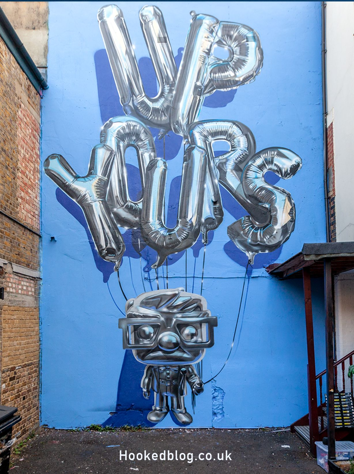 Hyper realistic up yours helium balloon mural painted by london graffiti artist fanakapan on heneage street off brick lane london