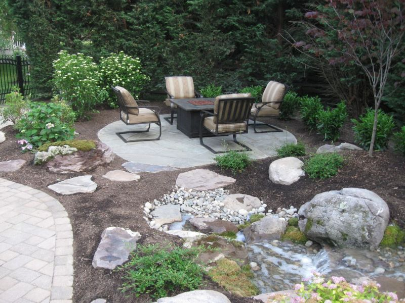Bluestone Seating area for garden next to waterfall in Bel