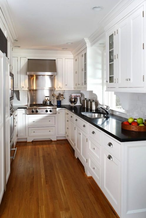 Gorgeous kitchen (SallyL: Ahmann LLC - Absolute black granite countertops  with white cabinetry and honey coloured flooring)