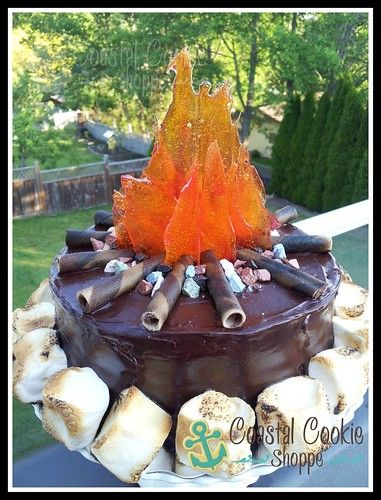 Camp Fire cake with candy flames and edible chocolate pebbles.