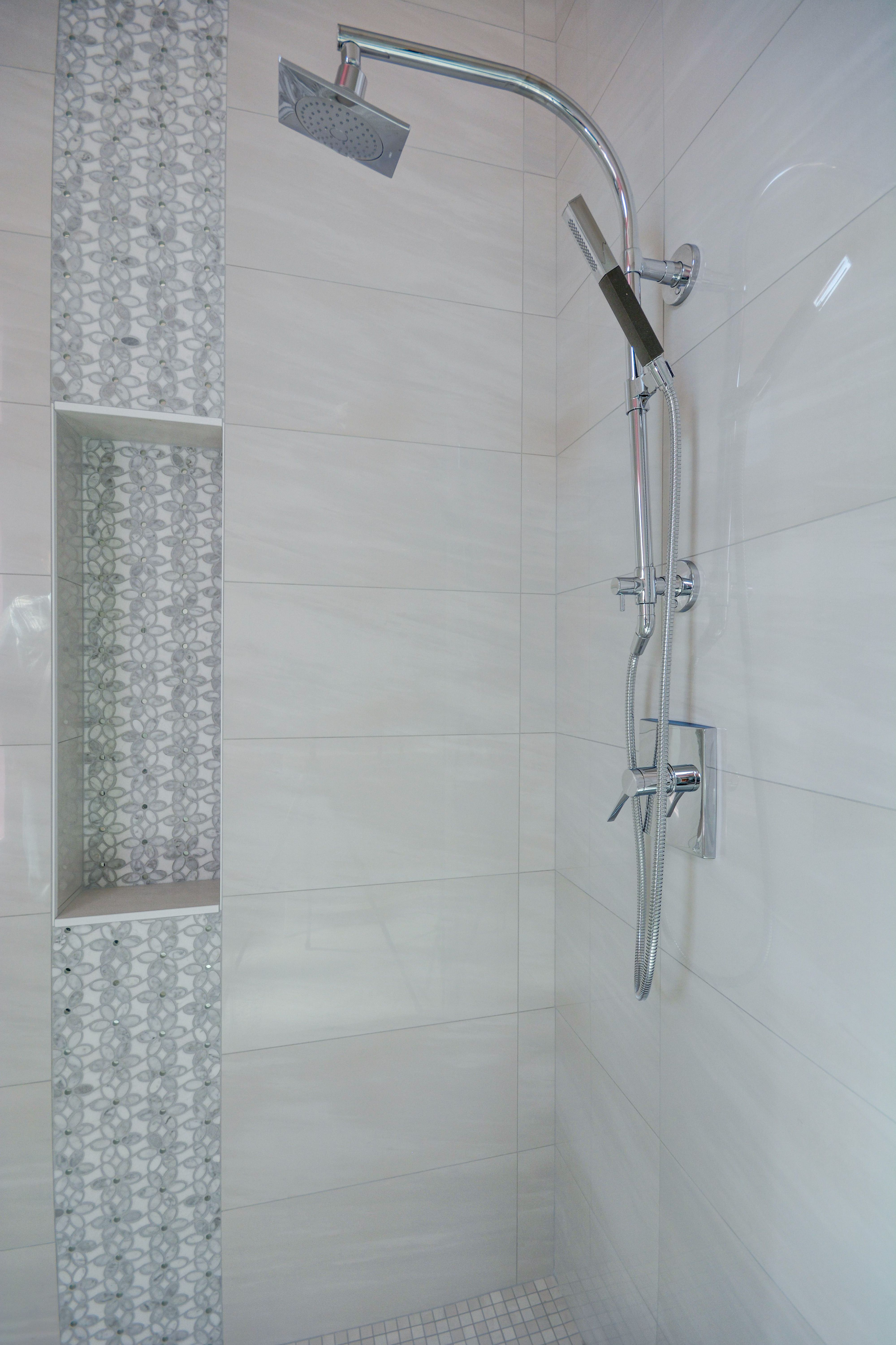 Bathroom Shower Design With White Marble Look Tile Shower Walls
