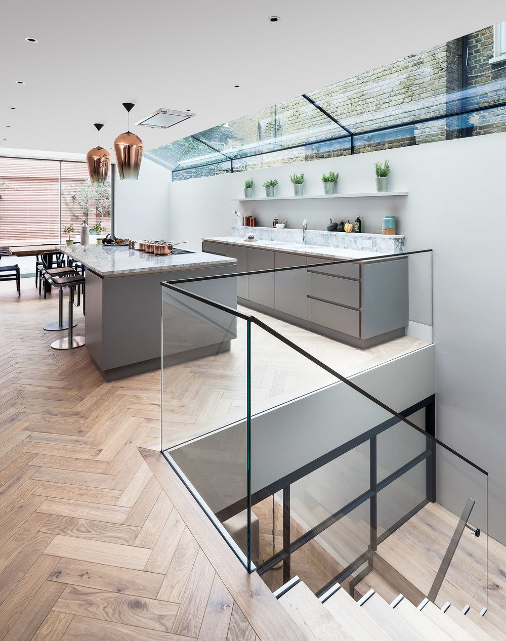Kitchen and stairs down to basement. Glass balustrade ...