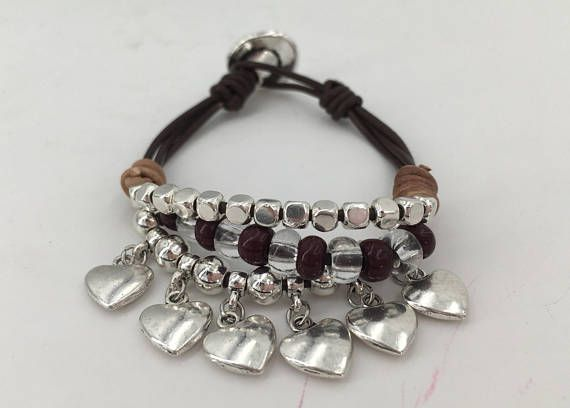 NOTE: FREE TRACKING SHIPMENT IN ALL ORDERS ABOVE 60 €!!! Woman bracelet handmade of high quality leather, resin beads and silver covered Zamak. Ideal for a casual look. For any occasion. All findings have sterling silver coat. Zamak is an alloy of zinc, aluminium, magnesium and copper. It