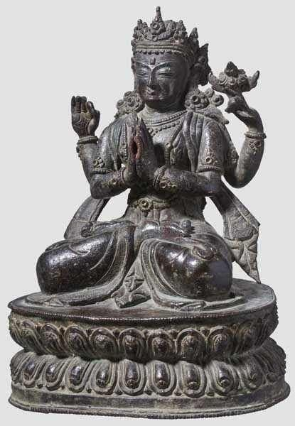 A Chinese bronze figure of Sadaksharilokesvara, late Ming period Figure worked in high quality with finely carved and engraved details. Portrayal of the seated Sadaksharilokesvara on a double lotus base. The underside of the base with punch mark kogomandala and small loss. Height 22.5 cm.
