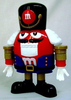 6d5f7344b This nutcracker is ready for holiday fun. He even brings some M&M chocolate  candies to the party. #nutcracker
