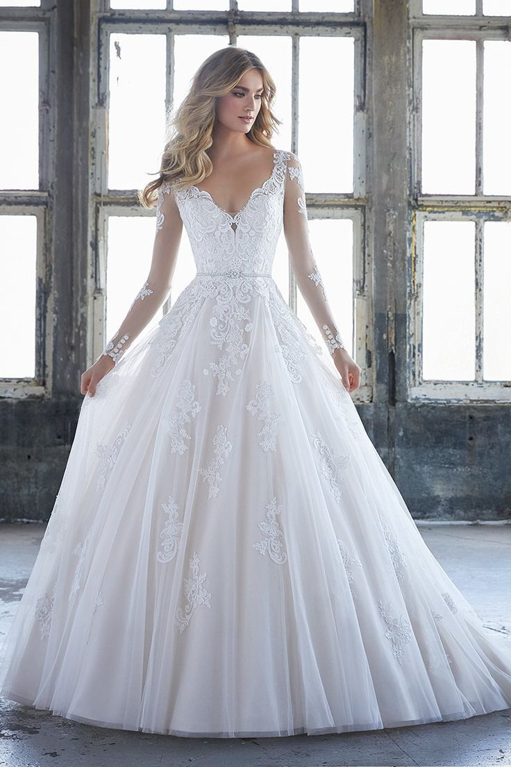 Wedding dress with lace sleeves  Ball gown wedding dress idea with vneckline and long lace sleeves