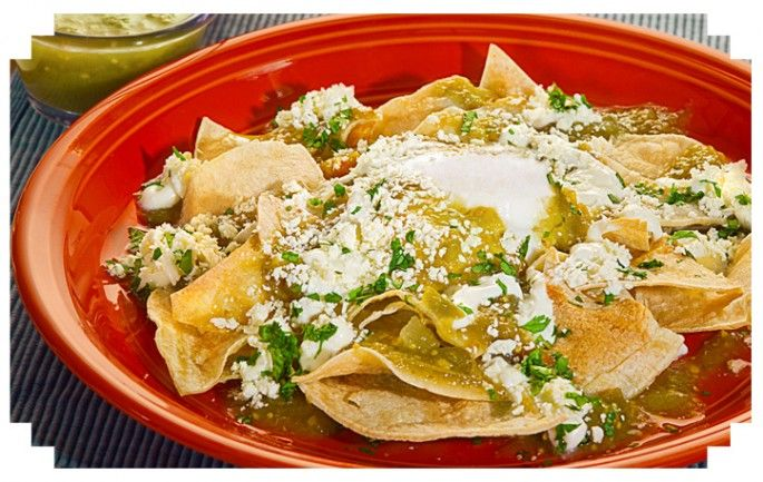 CHILAQUILES WITH POACHED EGGS AND REFRIED BEANS. (Topped ...
