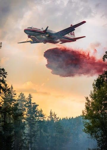 An air tanker drops a load of fire retardant on a wildfire near Vernon.