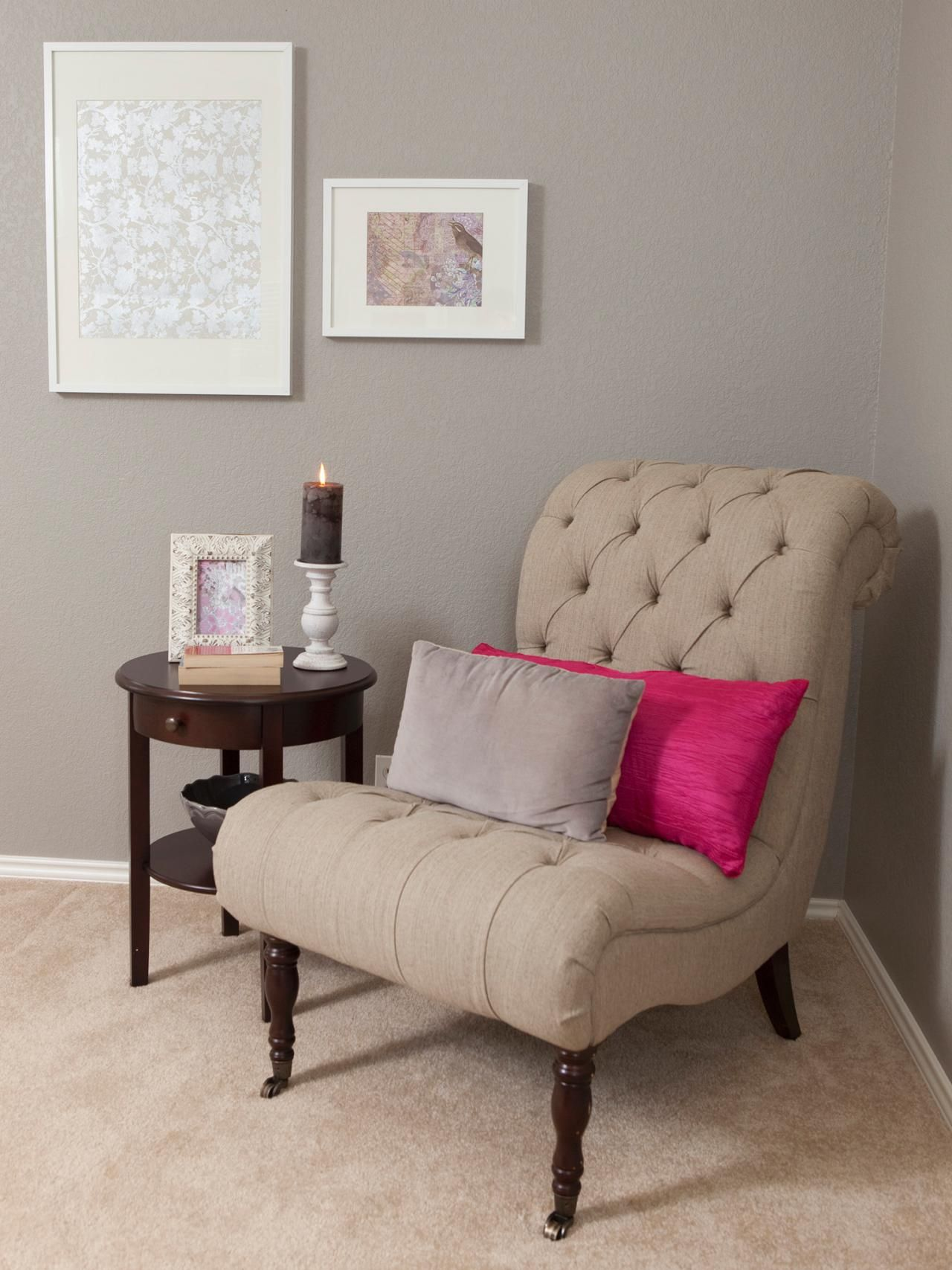 See A Traditional Gray Bedroom Sitting Area With Neutral Tufted Chair Accented By Throw Pillows