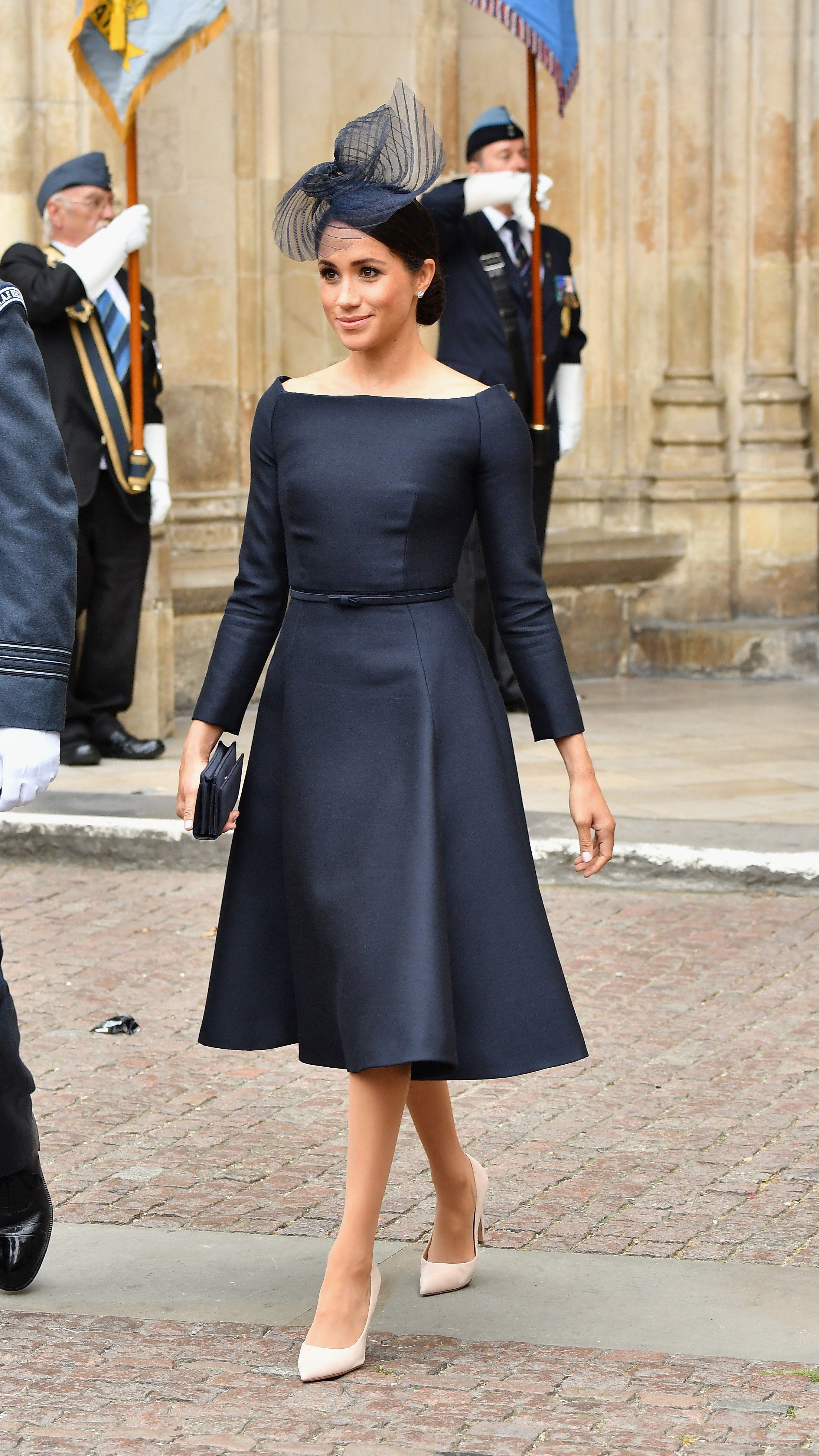 2507ea969aa Beautiful Meghan markle in a simple but elegant navy blue dress. Royal  Fashion