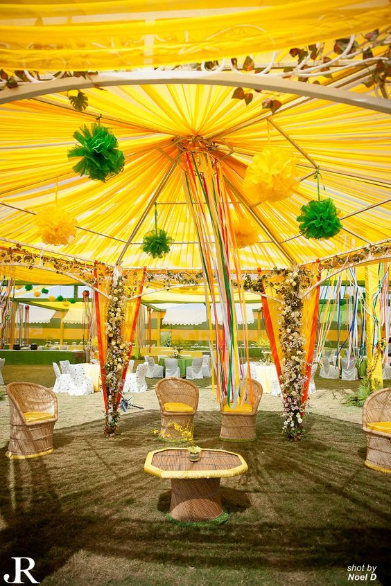 love this decor in yellow tent with yellow canopy hanging ribbons bamboo chairs outdoor mehendi decor indian wedding decor ideas floral - Yellow Canopy Decor