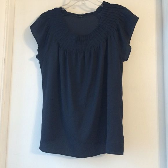Super versatile navy blouse Ann Taylor navy blouse.  Parent with white skinny jeans in the spring or wear it to work with a pencil skirt Ann Taylor Tops