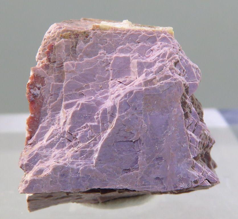 Natrokomarovite, (Na,Ca,H)2Nb2Si2O10(OH,F)2 · H2O, Kirov Mine, Khibiny Massif, Kola, Russian Federation. Silky-pinkish crystal aggregate. Type locality