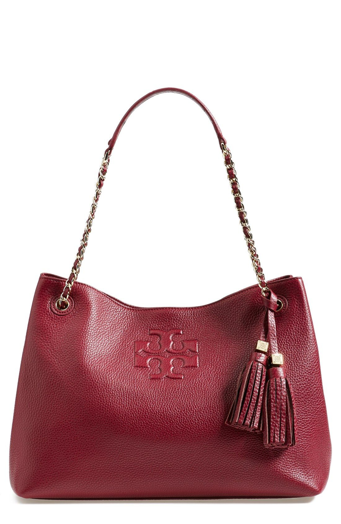 2321ef87e07 Lusting over this rich red Tory Burch tote, complete with tassels ...