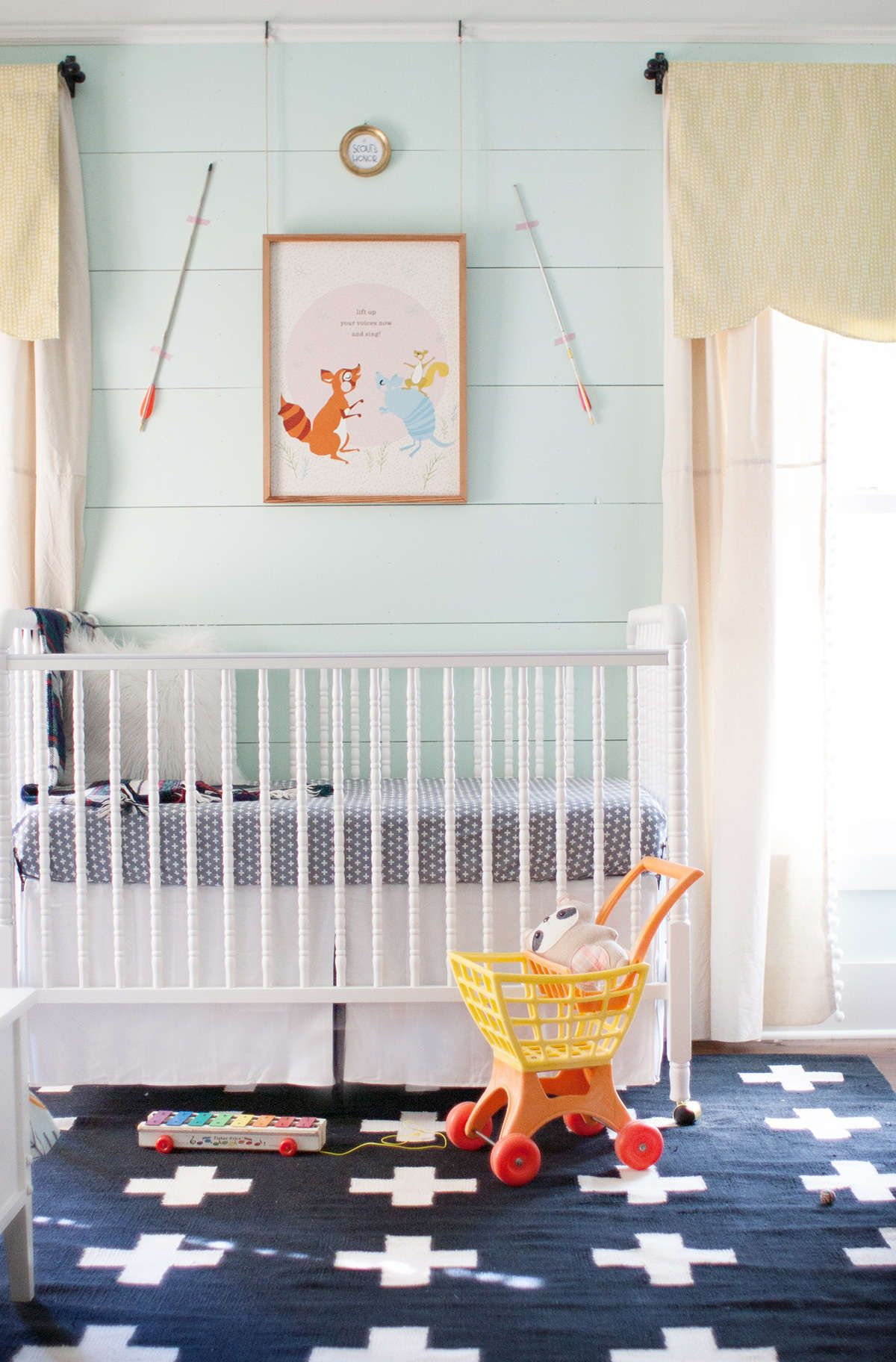 Nursery With Pale Mint Walls And Graphic Navy Rug Lay Baby