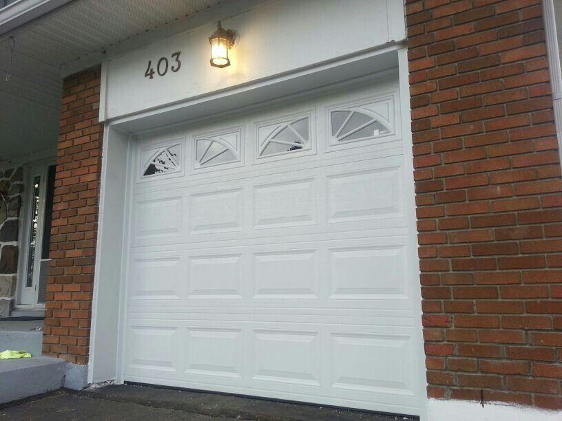 Olympus Model Door From Amarr With Wagon Wheel Inserts Garage Door Styles Carriage House Doors Wooden Garage Doors