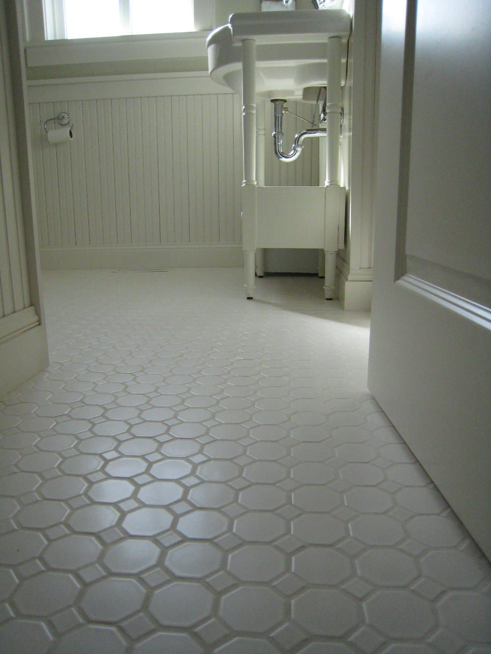 White porcelian, hexagon floor tile shown installed. The type of ...