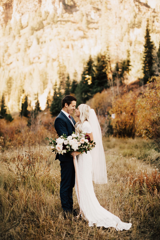Outdoor wedding mountains sunset boho big bouquets fields
