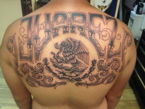 Black and grey mexican heritage back tattoo by joe charles for Mexican heritage tattoos