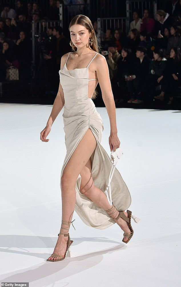 Gigi Hadid flaunts her endless pins in a slinky gown during PFW