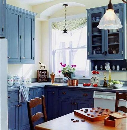 Beautiful farmhouse kitchen with two-tone, blue cabinets featuring a ...