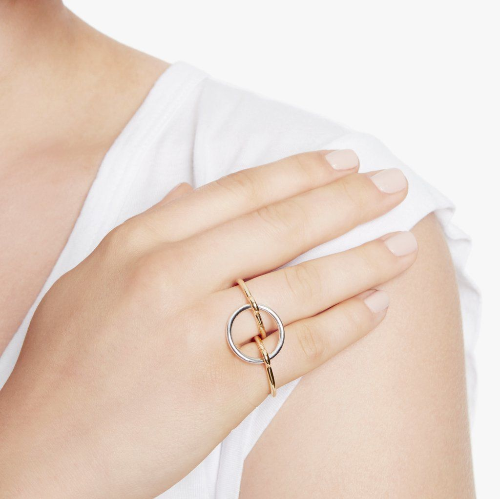 Charlotte Chenais' distinctive take on the dainty gold ring can be worn two…