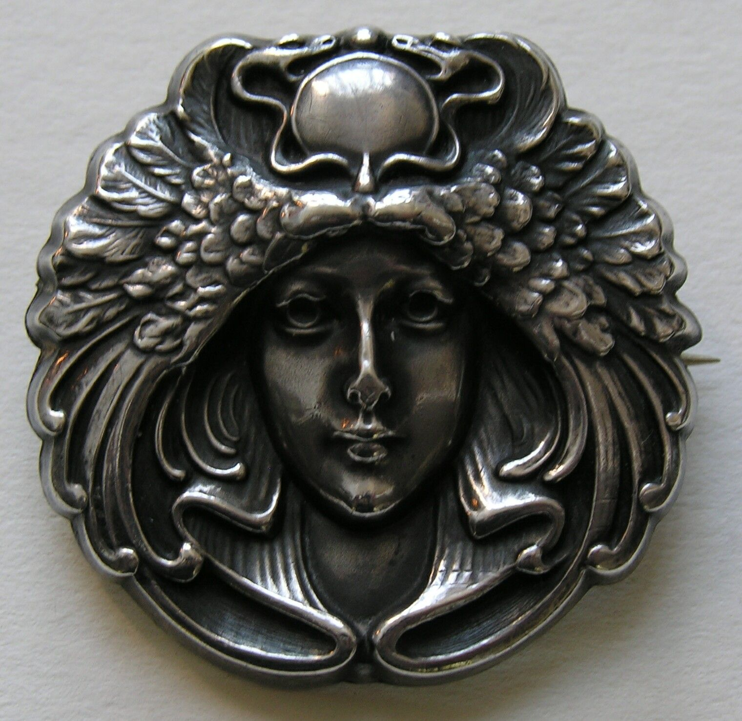 Blackinton Egyptian Revival Lady Sterling Brooch  This striking period brooch (circa 1900) features a lady with an Egyptian winged serpent headdress.