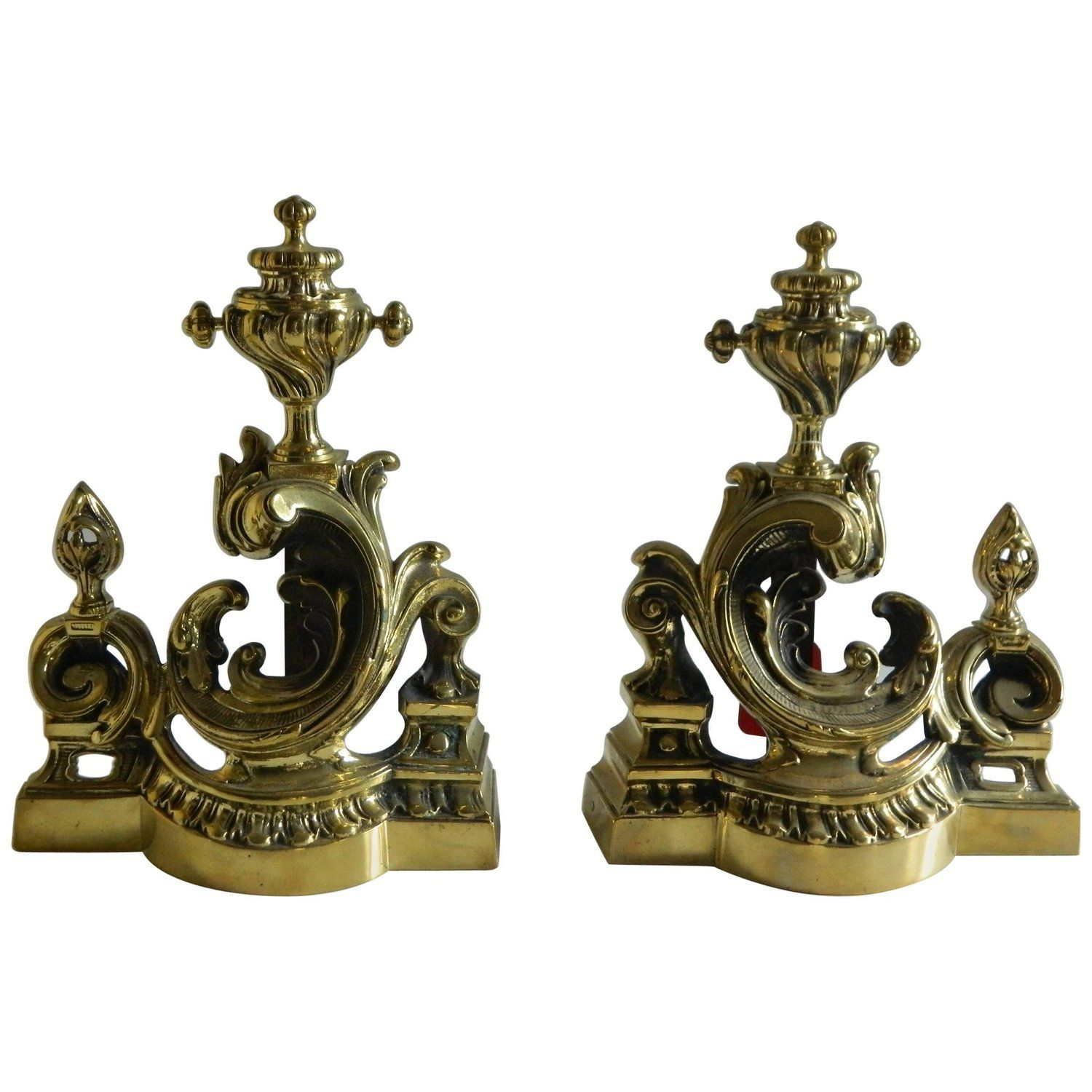 pair of polished brass chenets or andirons scroll motif 19th