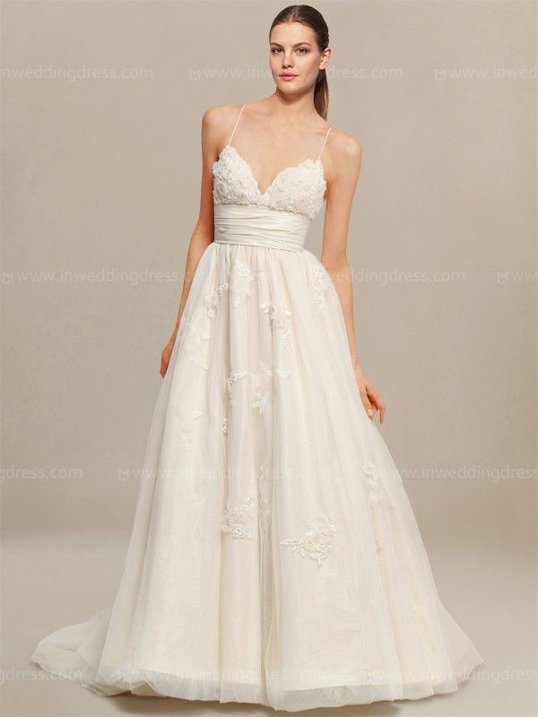 d3b14f9440 Informal wedding dress features a breathtakingly dramatic bodice with spaghetti  straps crisscross in the back. Delicate Lace appliques are adorned on the  ...