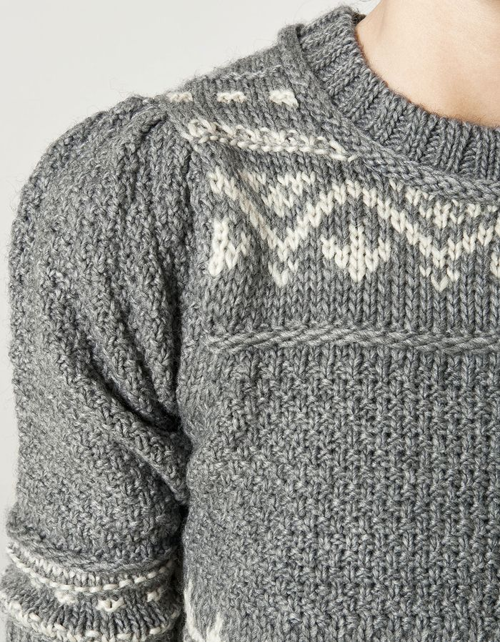 Beautiful sweater. Learn how to make sleeves like that