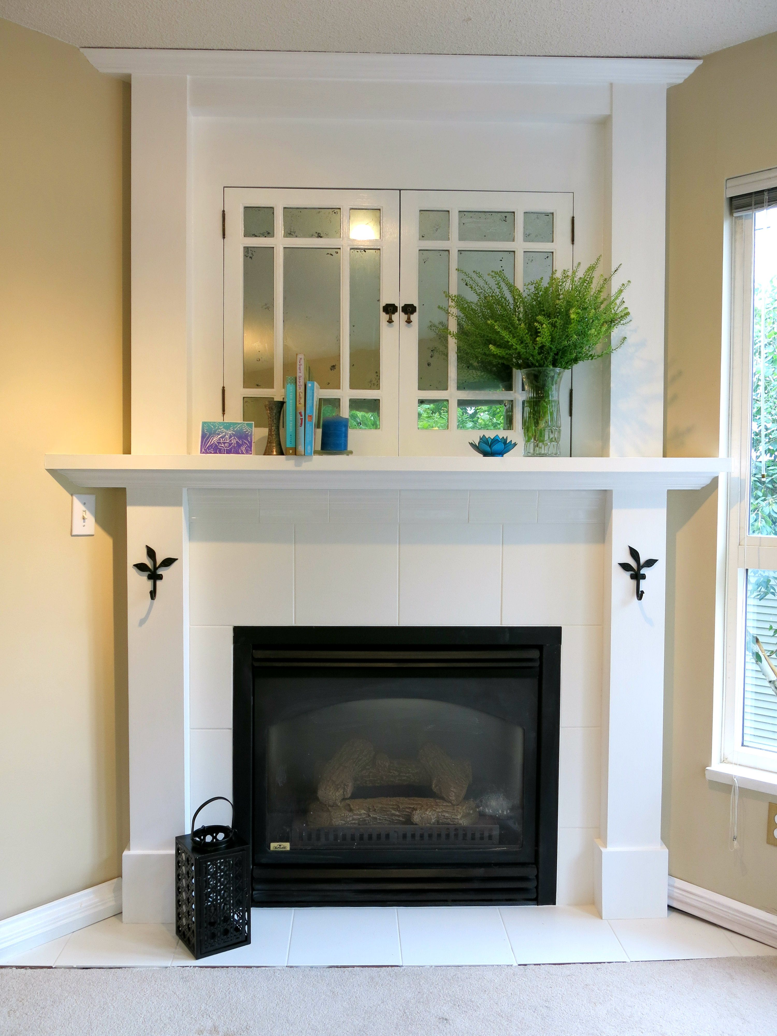 Faux Mercury Glass Old Cabinet Doors, White Tile Fireplace Surround,  Vintage Entertainment Unit,