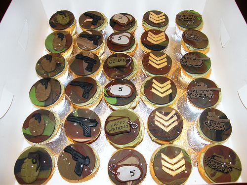 Militarythemed cupcakes with M4s hand grenades and rank insignia