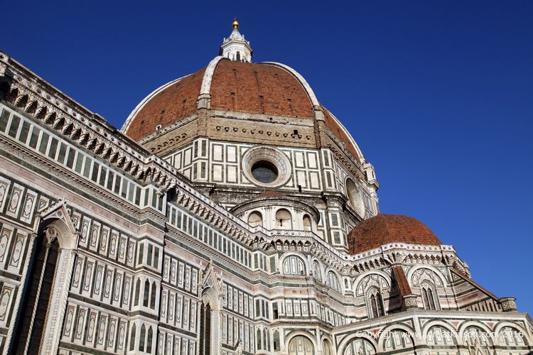 The Cathedral Of Santa Maria Del Fiore:  The exterior of the basilica is faced with polychrome marble panels in various shades of green and pink bordered by white and has an elaborate 19th-century Gothic Revival façade by Emilio De Fabris.