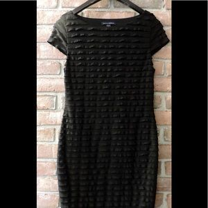 I just added this to my closet on Poshmark: BANANA REPUBLIC - XS Black RUFFLE Sheath Dress. Price: $22 Size: XS